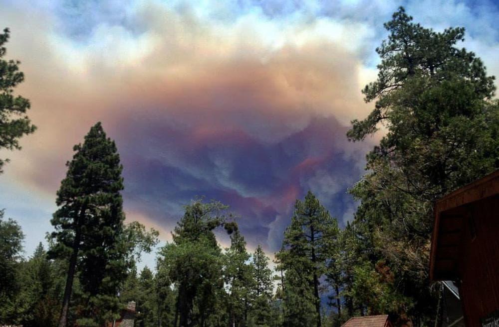 This July 17, 2013 image provided by Meagan Greene shows wildfire smoke near Idyllwild, Calif. (Meagan Greene/AP)