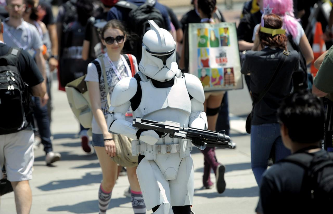 A Stormtrooper makes his way through the crowd during Day 2 of Comic-Con International on Thursday, July 18, 2013 in San Diego, Calif. (Chris Pizzello/Invision via AP)