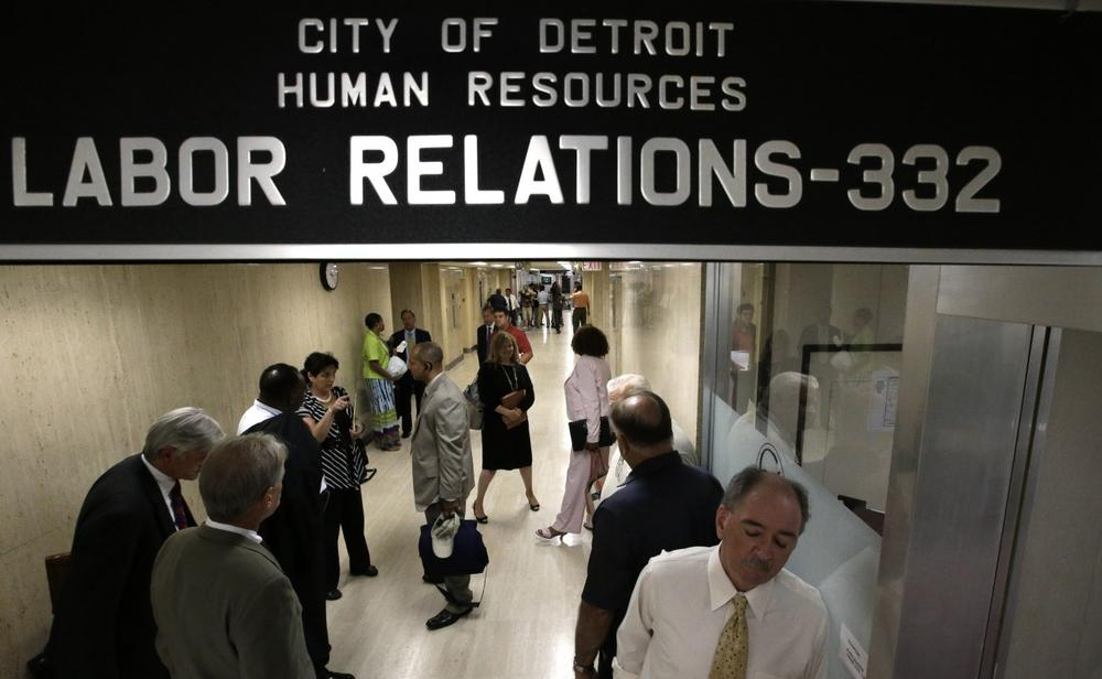 Representatives of Detroit's active and retired public workers wait for a meeting in Detroit, Wednesday, July 10, 2013. (Paul Sancya/AP)