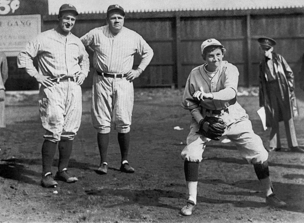 New York Yankees legends Lou Gehrig (L) and Babe Ruth watch Jackie Mitchell warm up before an exhibition game in Tenneessee in 1931. (AP)