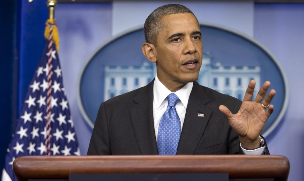 President Barack Obama gestures as he speaks during the daily news briefing at the White House, Friday, July 19, 2013, in Washington, about the fatal shooting of Trayvon Martin by George Zimmerman. (Carolyn Kaster/AP)