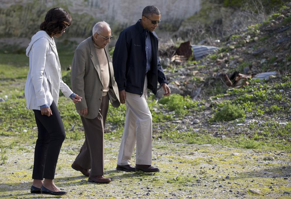 U.S. President Barack Obama, right, and first lady Michelle Obama, left, tour Robben Island with Ahmed Kathrada, who was imprisoned with Nelson Mandela, Sunday, June 30, 2013, in South Africa. (Evan Vucci/AP)