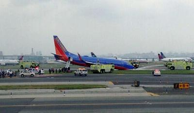 This photo provided by Bobby Abtahi, shows what officials say was a plane where the nose gear collapsed during landing at New York's LaGuardia Airport, Monday, July 22, 2013. (Bobby Abtahi via AP)