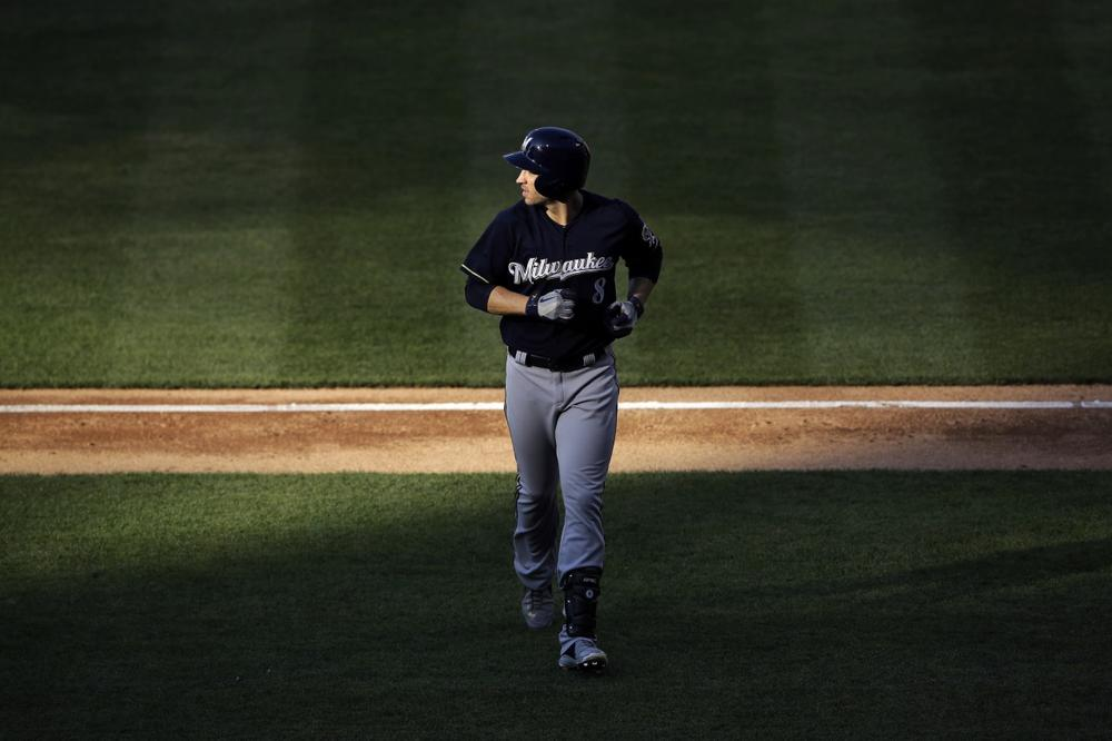 Ryan Braun's suspension is just one of many recent examples of athletes who should not be considered role models. (Matt Slocum/AP)
