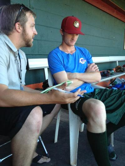 reporter Dave Southorn before a recent home game. The 20-year-old outfielder is attracting media attention at home and on the road. (Scott Graf)