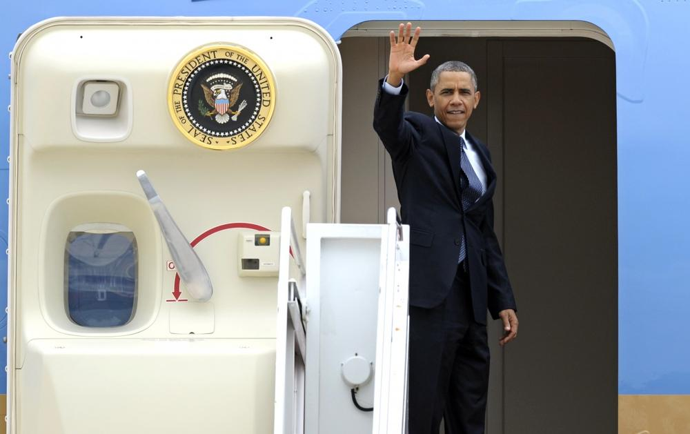 President Barack Obama waves as he boards Air Force One, Wednesday, July 24, 2013. (Cliff Owen/AP)