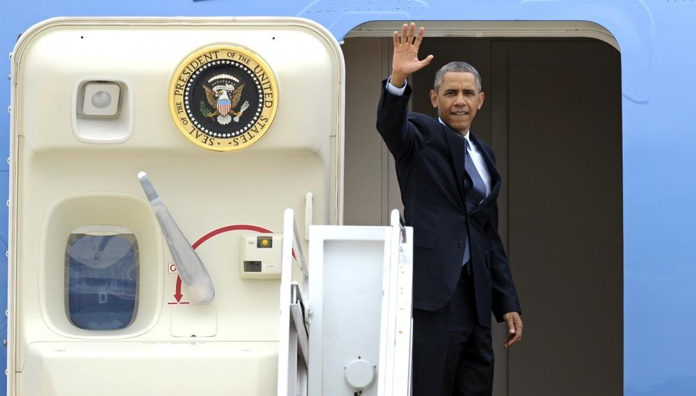 President Barack Obama waves as he boards Air Force One at Andrews Air Force Base, Md., Wednesday, July 24, 2013. (Cliff Owen/AP)