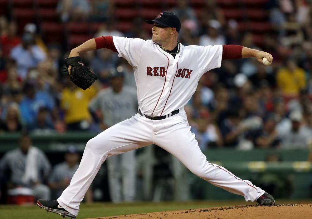 Boston Red Sox starting pitcher Jon Lester delivers to the Tampa Bay Rays. (Elise Amendola/AP)