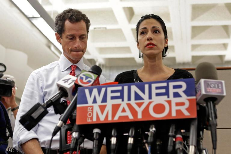 New York mayoral candidate Anthony Weiner, left, listens as his wife, Huma Abedin, speaks during a news conference on July 23, 2013, in New York. The former congressman says he's not dropping out of the New York City mayoral race in light of newly revealed explicit online correspondence with a young woman. (Kathy Willens/AP)