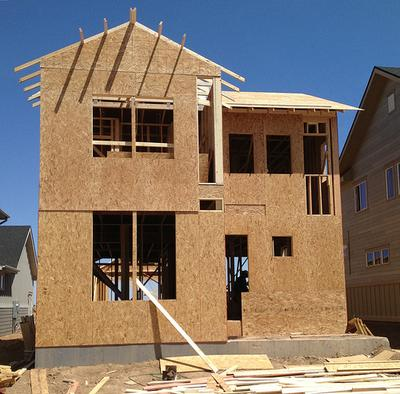 A home under construction by New Town Builders in Denver's Stapleton neighborhood. The company is building 78 homes, and all but one have already sold. (Ben Markus/Colorado Public Radio)