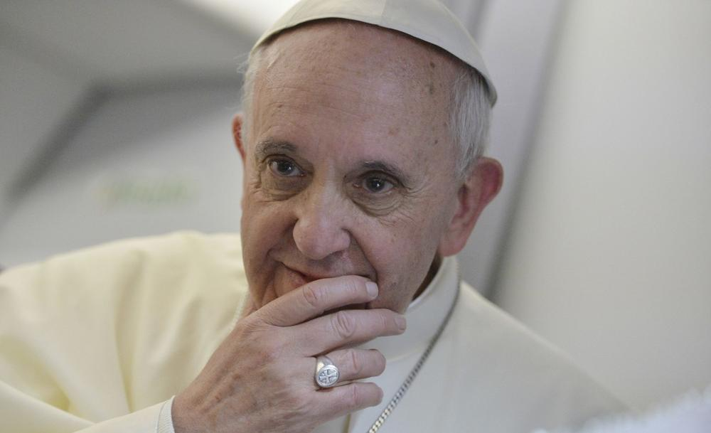 Pope Francis speaks during a news conference aboard the papal flight on its way back from Brazil, Monday, July 29, 2013. (Luca Zennaro/AP)