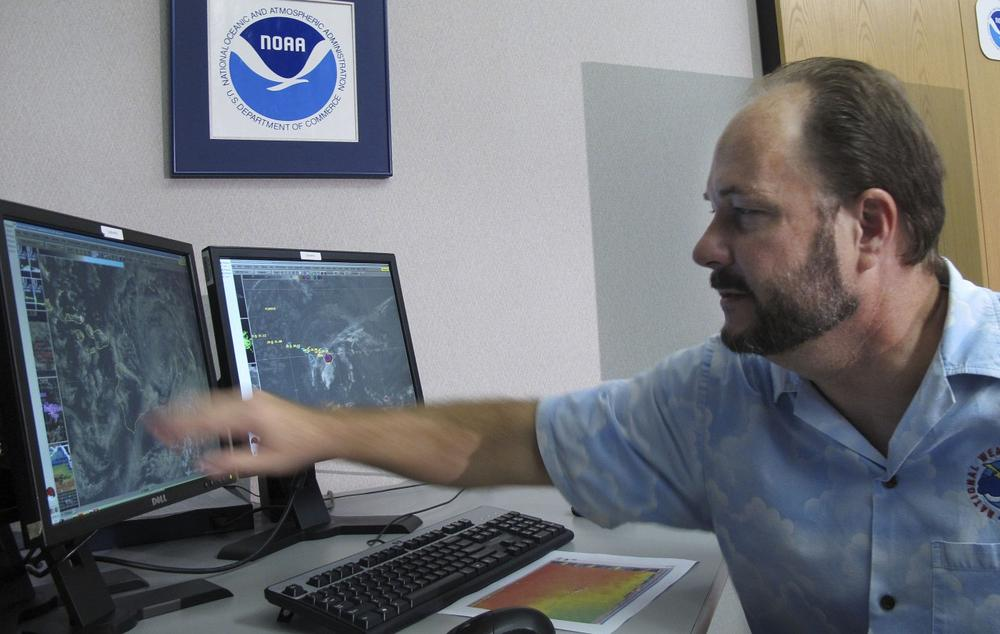 Tom Evans, acting director of the Central Pacific Hurricane Center, shows satellite images of Hurricane Flossie in Honolulu on Monday, July 29, 2013. (Oskar Garcia/AP)