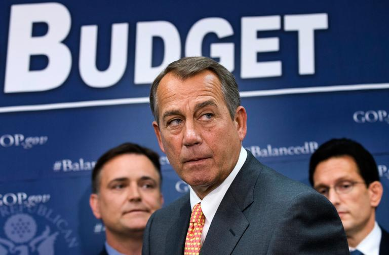 House Speaker John Boehner of Ohio, flanked by House Majority Leader Eric Cantor of Va., right, and Rep. Luke Messer, R-Ind., on Capitol Hill in Washington. (J. Scott Applewhite/AP)