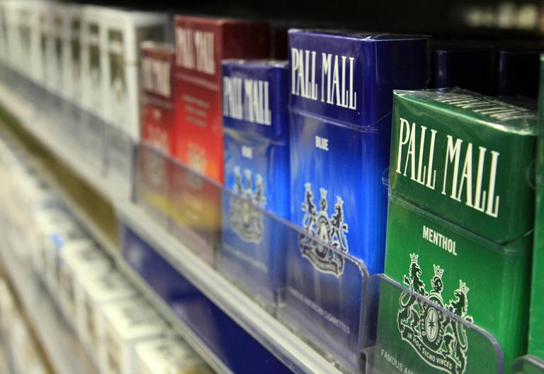 Boxes of cigarettes sit on shelves in a Brunswick, Maine, store. (Pat Wellenbach/AP)