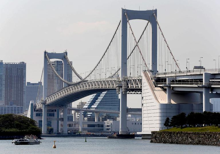 A ferry goes by the Rainbow Bridge in Tokyo, a single-span suspension bridge over half a mile long. (Itsuo Inouye/AP)
