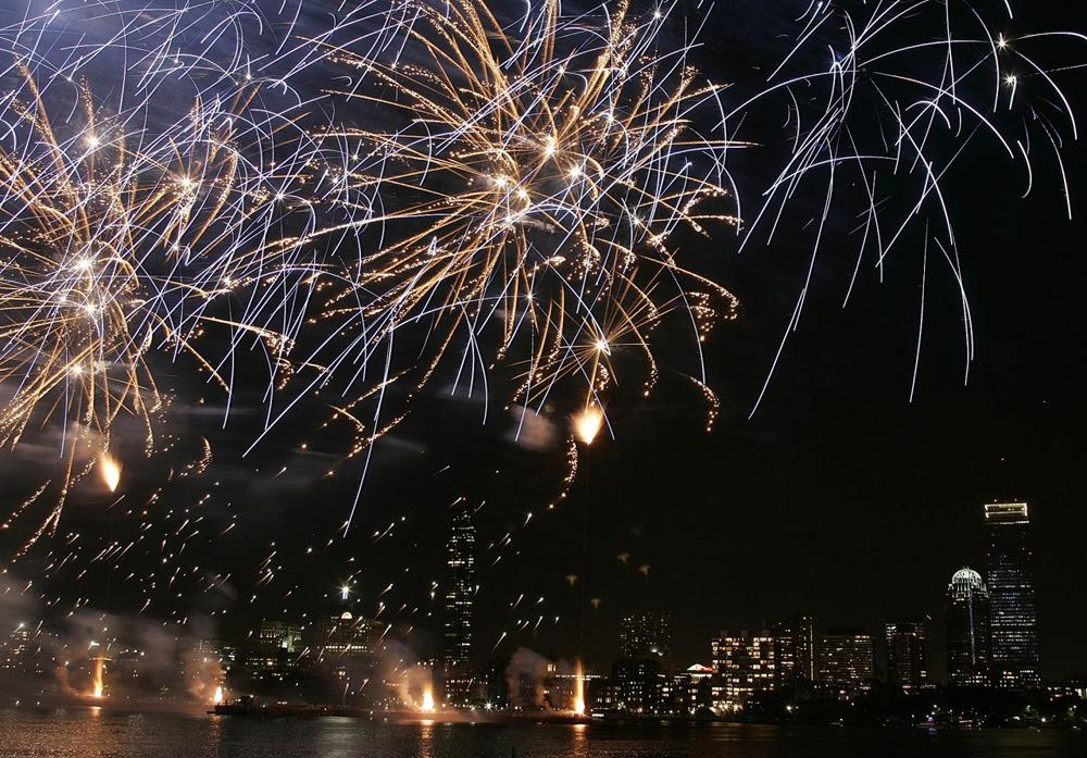 Fireworks explode over the Charles River and the Boston skyline Monday, July 4, 2005. (Winslow Townson/AP)