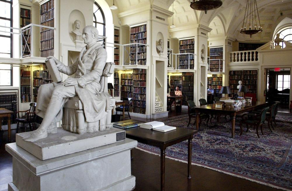 A statue of Nathaniel Bowditch's (1773-1838), a leading author in Navigation, Astronomy, and Mathematics, is seen inside The Boston Athenaeum Library Monday, Aug. 8, 2005 in Boston. The Boston Athenaeum, one of the oldest and most distinguished independent libraries in the United States, was founded in 1807 by members of the Anthology Society, a group of fourteen Boston gentlemen who had joined together in 1805 to edit The Monthly Anthology and Boston Review. (Bizuayehu Tesfaye/AP)