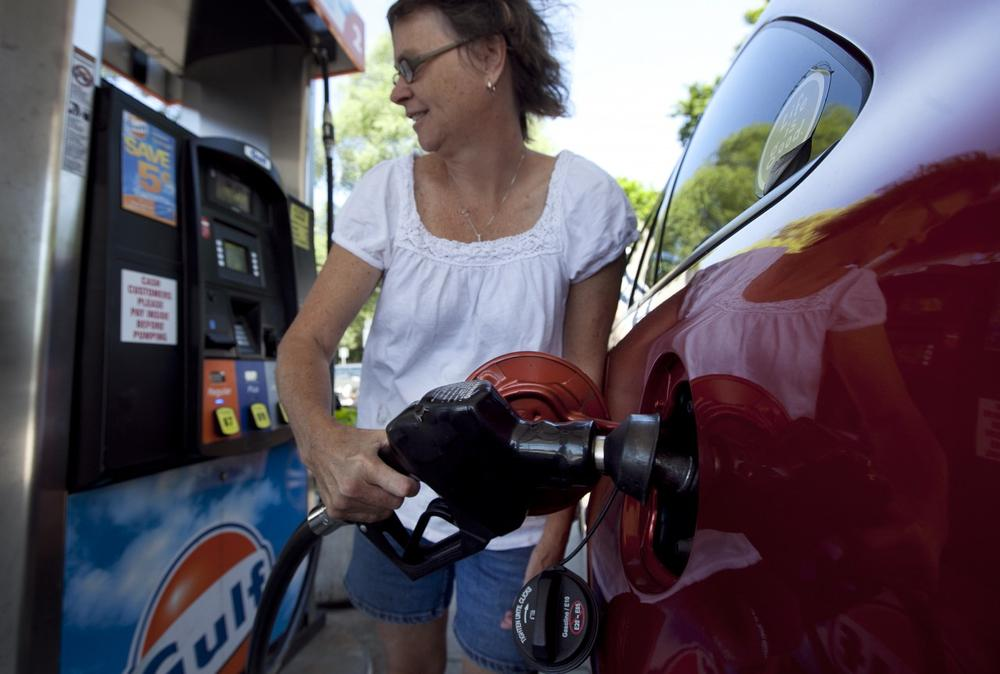 The tax on gas in Mass. is likely to go up, but lawmakers are fighting over just how much. (Steven Senne/AP)