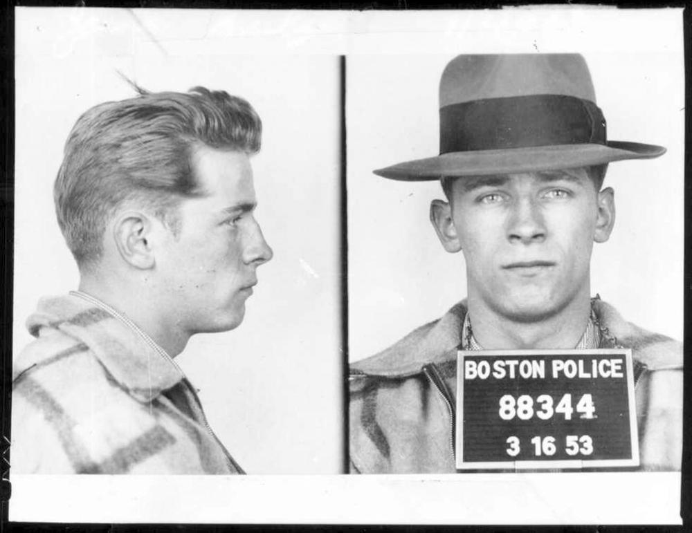 """This 1953 Boston police booking photo shows James """"Whitey"""" Bulger after an arrest. Bulger and his girlfriend Catherine Greig, were apprehended Thursday, June 23, 2001, in Santa Monica, Calif., after 16 years on the run. Opening statements in his trial were made in U.S. District Court in Boston Wednesday, June 12, 2013. Bulger faces a long list of crimes, including extortion and playing a role in 19 killings. (AP Photo/Boston Police)"""