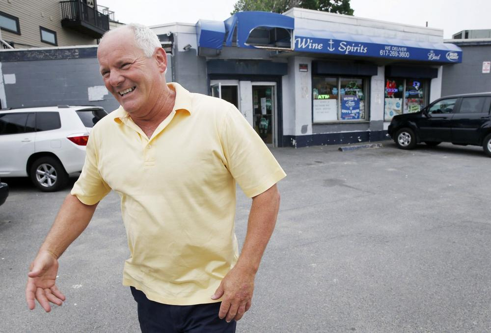 """In this Thursday, June 6, 2013, file photo Stephen Rakes smiles after greeting an acquaintance outside the liquor store he once owned in the South Boston neighborhood of Boston. Authorities say Rakes, who was on the witness list for the racketeering trial of reputed mobster James """"Whitey"""" Bulger, has died. The Middlesex District Attorney's Office says Stephen Rakes was found dead Wednesday, July 17, 2013 about 1:30 p.m. in Lincoln, Mass., with no obvious signs of trauma to his body. (AP Photo/Michael Dwyer)"""