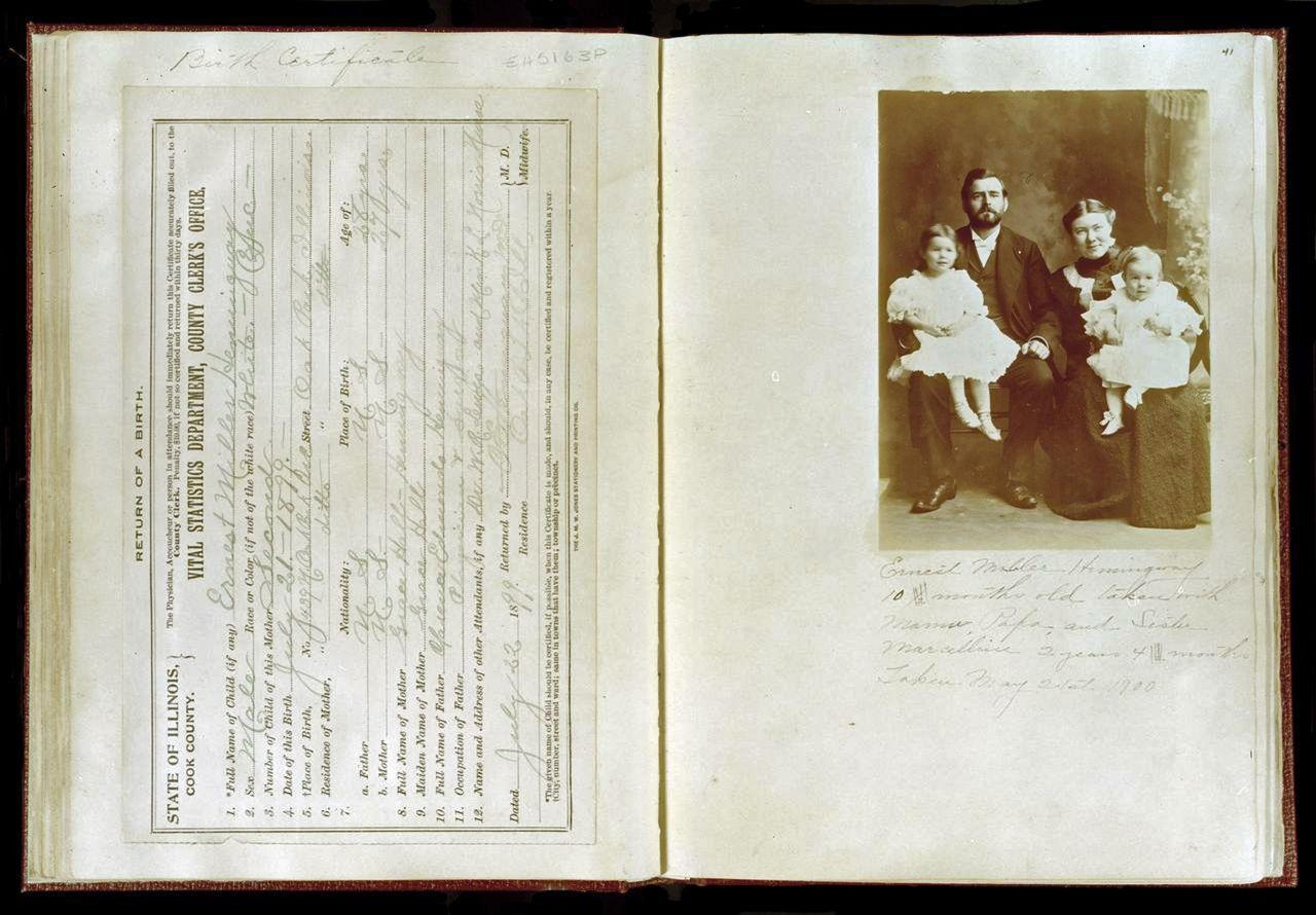 This photo provided by the John F. Kennedy Presidential Library shows the birth certificate and family photograph of Ernest Hemingway from a scrapbook created by his mother, Grace Hall Hemingway. (John F. Kennedy Presidential Library/AP)