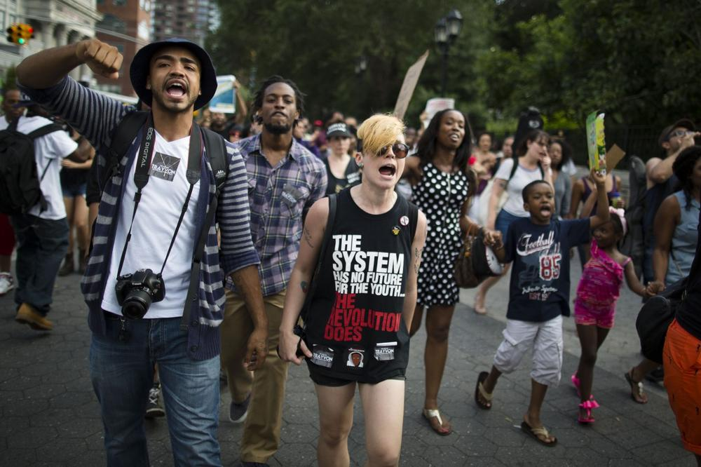 Demonstrators march in Union Square, Sunday, July 14, 2013, in New York,during a protest against the acquittal of neighborhood watch member George Zimmerman in the killing of 17-year-old Trayvon Martin in Florida. Demonstrators upset with the verdict protested mostly peacefully in Florida, Milwaukee, Washington, Atlanta and other cities overnight and into the early morning. (John Minchillo/AP)