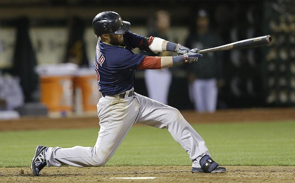 Dustin Pedroia swings for a two run single off Oakland Athletics' Ryan Cook in the eighth inning Friday in Oakland, Calif. (Ben Margot/AP)