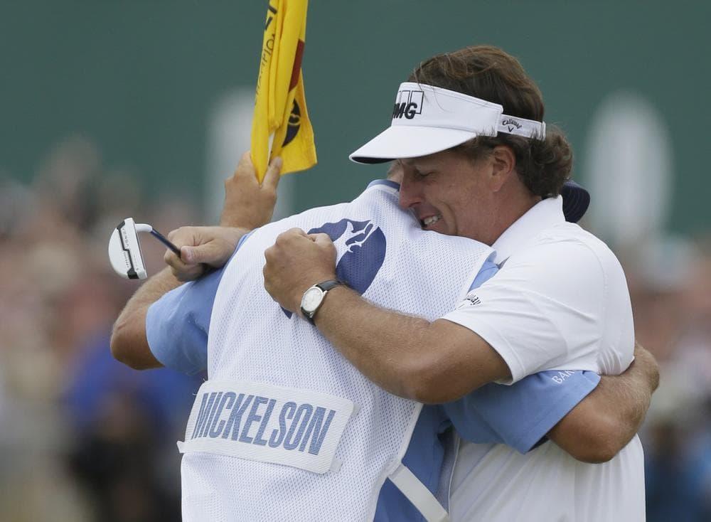 "Mickelson celebrates with his caddie Jim ""Bones"" Mackay. (Jon Super/AP)"
