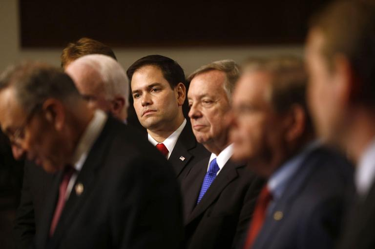 In this April 18, 2013 file photo, Sen. Marco Rubio, R-Fla., center, and others Senators, participate in a news conference on immigration on Capitol Hill in Washington. (AP)