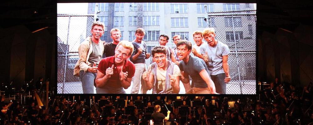 "David Newman conducts the Boston Symphony Orchestra in sync with the movie version of ""West Side Story."" (Hilary Scott)"