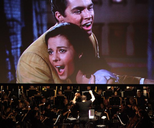 "David Newman conducts the Boston Symphony Orchestra in sync with the film version of ""West Side Story."" (Hilary Scott)"