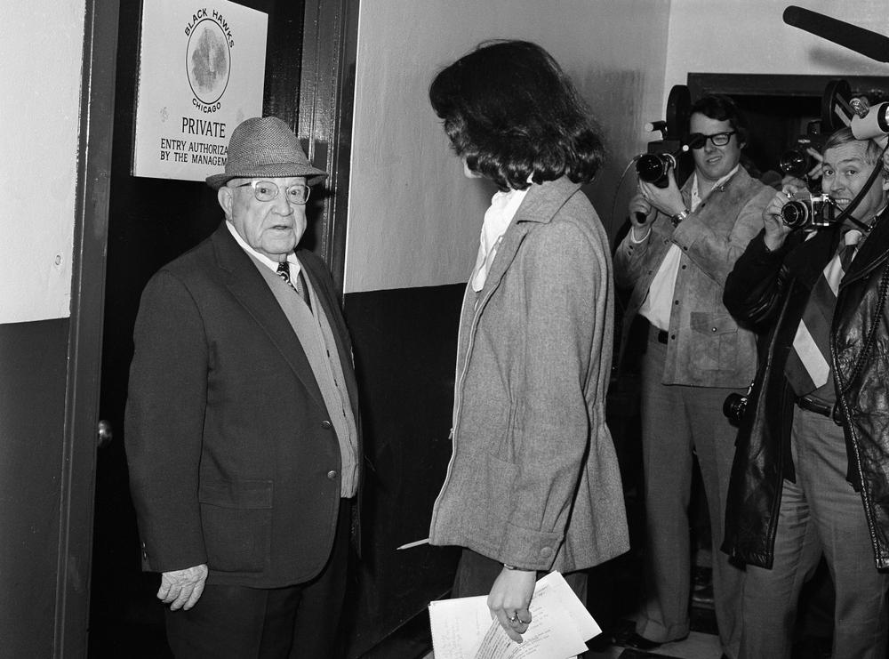 Robin Herman, sports writer for the New York Times, is confronted by Chicago Black Hawks doorman Gordon Robertson outside the Black Hawks dressing room at Chicago, Jan. 24, 1975. Robertson kept Miss Herman from interviewing Black Hawks players until Chicago Black Hawks coach Billy Reay felt the team was presentable. Black Hawks won against New York Islanders, 3-1. (AP Photo)