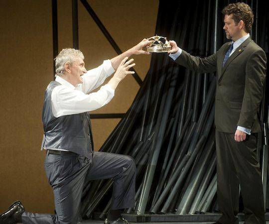 "Rocco Sisto as Richard II hands the crown, wryly, to Bolingbroke in ""Richard II."" (Kevin Sprague)"