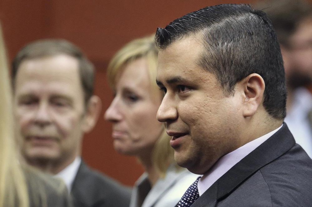 George Zimmerman leaves court with his family after Zimmerman's not guilty verdict was read in Seminole Circuit Court in Sanford, Fla. on Saturday, July 13, 2013. Jurors found Zimmerman not guilty of second-degree murder in the fatal shooting of 17-year-old Trayvon Martin in Sanford, Fla. (AP)