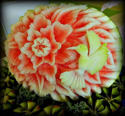Arroco used the red and white fruit inside the watermelon to create this hummingbird and flower design. (Courtesy of Ruben Arroco)