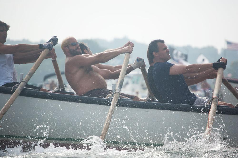Seine boat racers strain at their oars during Sunday's men's championship race. (Greg Cook)