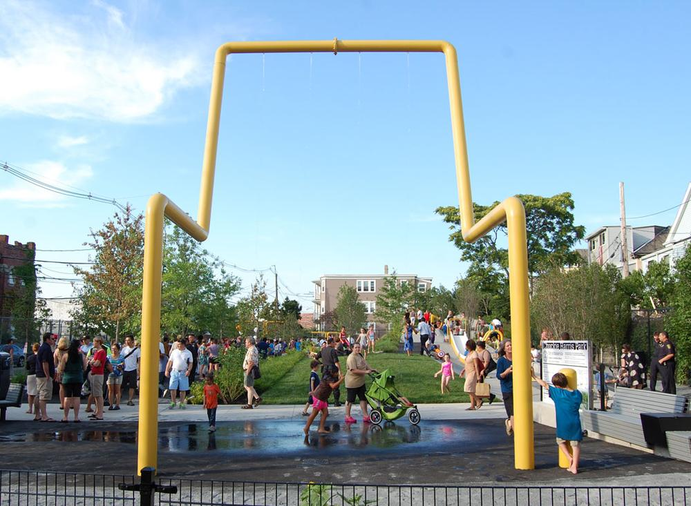 A signature feature of Harris Park is the water shower, which doubles as a support for a movie screen. (Greg Cook/WBUR)