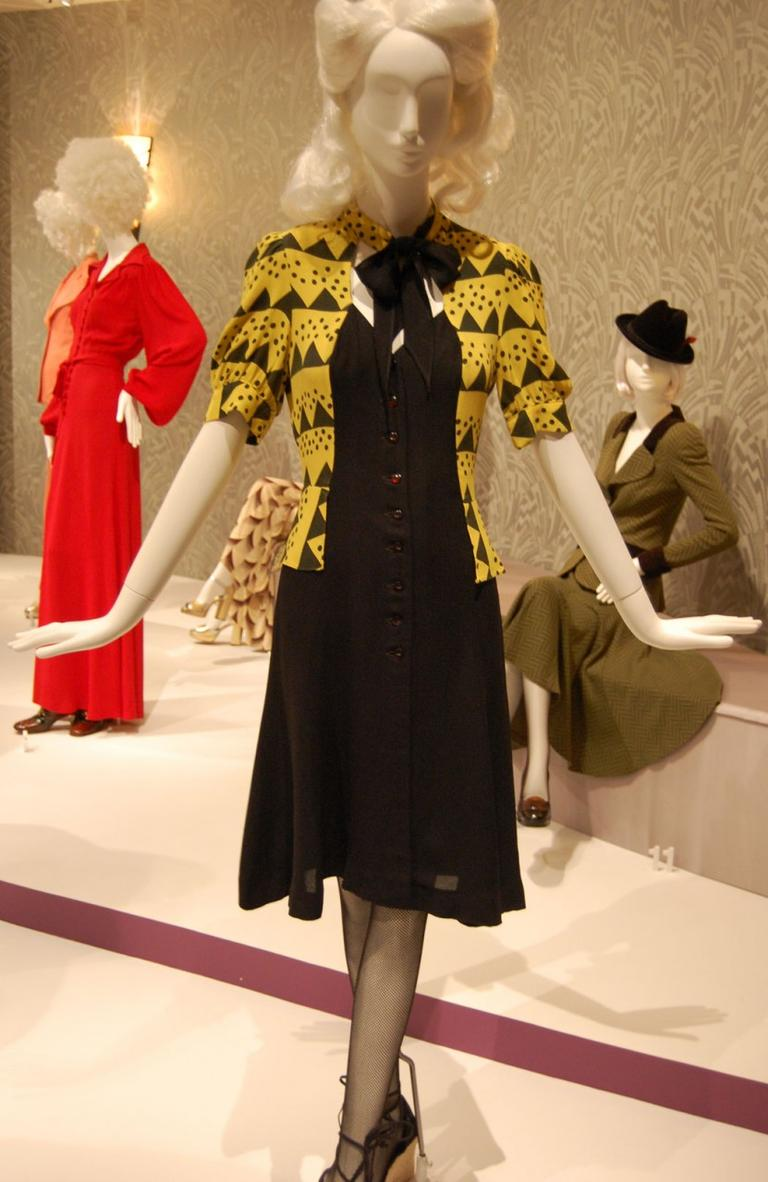 Ossie Clark helped revive the 1940s look with designs like this circa 1970 black button-down dress with a jacket (note the keyhole tie neckline) printed with an Art Deco pattern by Celia Birtwell. (Greg Cook)