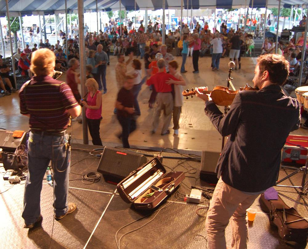 Couples dance in the Dutton Street Pavilion as Jesse Lége and Joel Savoy play Cajun tunes. (Greg Cook)