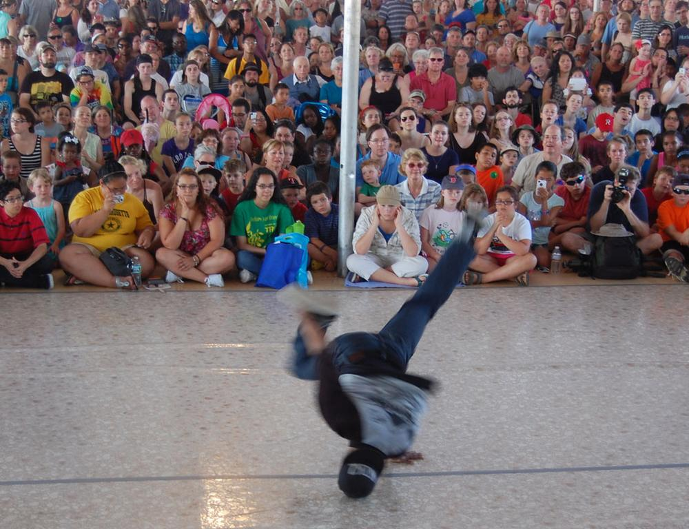 "Alfred Hibbert (aka Flo) of Dorchester competes in the ""Battle of Lowell"" breakdancing competition. (Greg Cook)"
