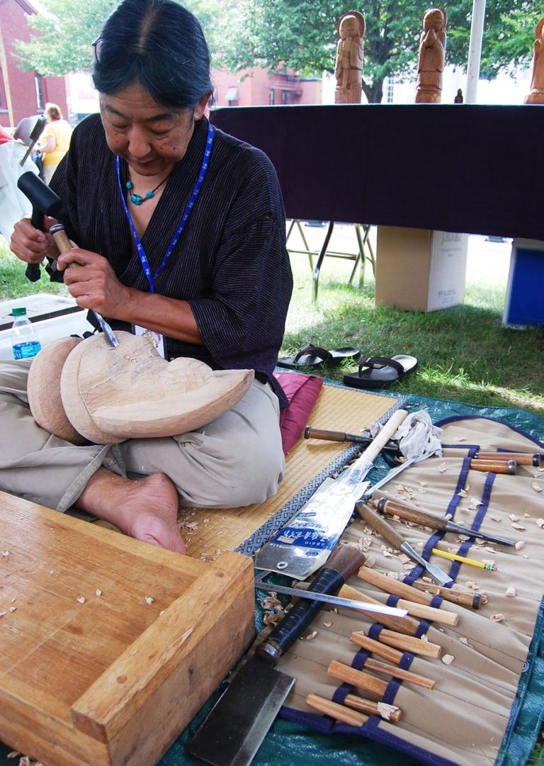 """I'm an artist and I have a Japanese background. I became interested in Buddhism and I was very interested in social change and the peace movement. I traveled to Japan and met a Buddhist sculptor and all those ideas came together,"" says Thomas Matsuda of Conway, who was carving an Amida Buddha from wood. ""I feel Buddhism is very peaceful and nonviolent. And bringing, not necessarily religion, but spirituality is important in our time. Not necessarily promoting Buddhism, but reverence and respect and compassion is what the world needs more of."" (Greg Cook)"