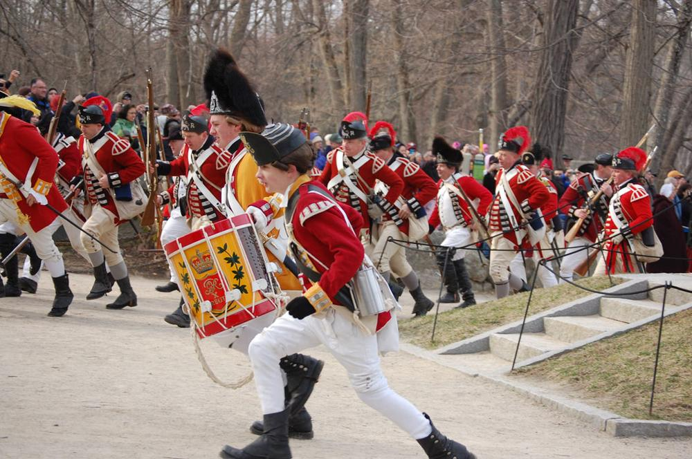British soldiers flee from the battle at Concord Bridge during a Patriots Day reenactment. (Greg Cook)