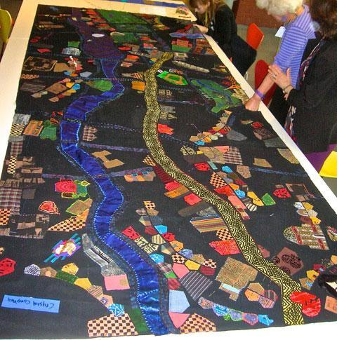 A yellow strip snaking down the middle of the quilt represents the marathon route. (Courtesy photo)