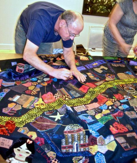 "Stitching buildings onto the ""Mending Boston"" quilt. (Courtesy photo)"