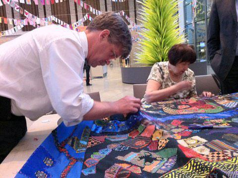 "Volunteers work on the ""Mending Boston"" quilt at the Museum of Fine Arts. (Courtesy photo)"