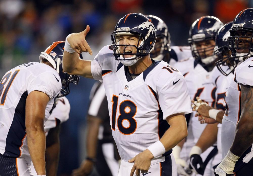 Broncos quarterback Peyton Manning knows he'll have to shout over the crowd when his team is on the road, but can he get the hometown crowd to keep it down? (Charles Rex Arbogast/AP)