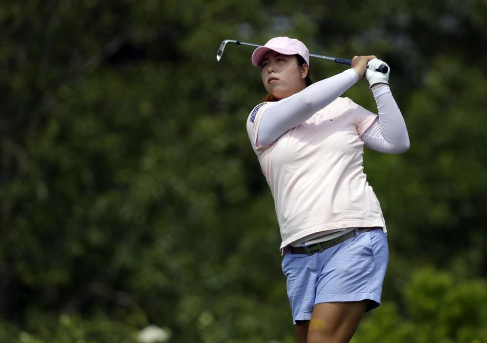 Shanshan Feng is the face of women's golf in China. (Seth Wenig/AP)
