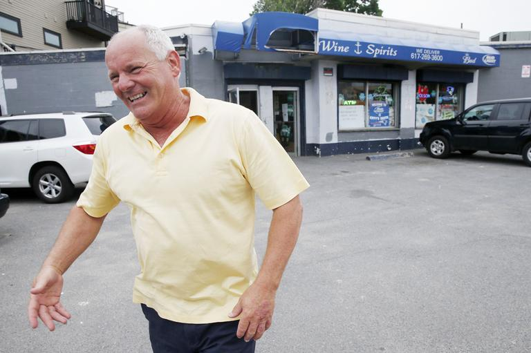 Stephen Rakes outside the liquor store he once owned in South Boston. (Michael Dwyer/AP)
