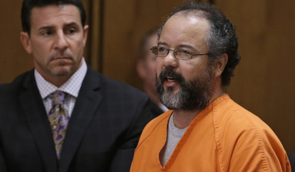 Ariel Castro, right, speaks during the sentencing phase as defense attorney Craig Weintraub watches Thursday, Aug. 1, 2013, in Cleveland. Castro was sentenced to life in prison plus 1,000 years. (Tony Dejak/AP)