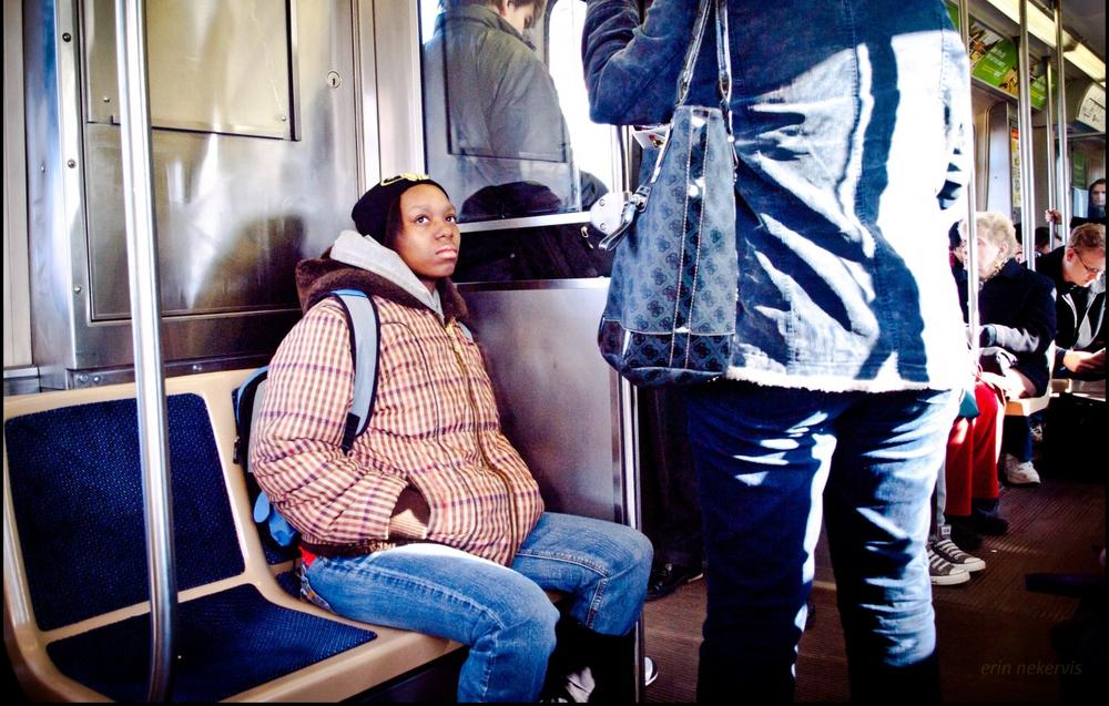 A passenger rides the L in Chicago. (TheeErin/Flickr)